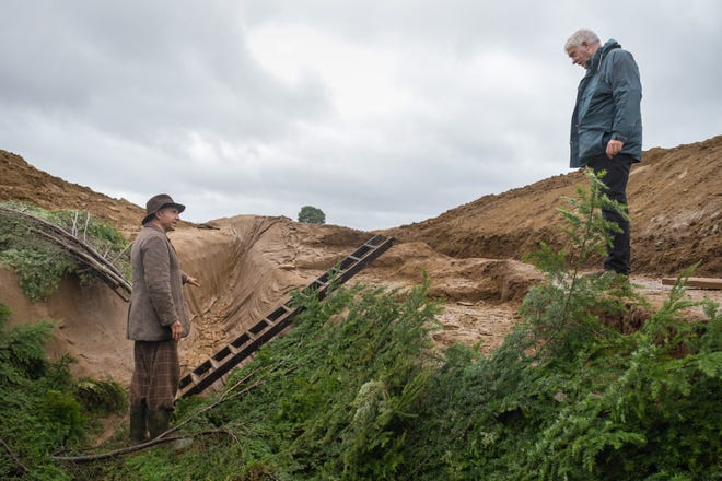 """Ralph Fiennes (as Basil Brown) gets instruction on the set of """"The Dig."""""""