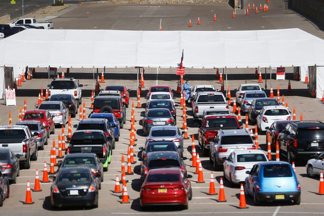 A drive-through COVID-19 testing site in November in El Paso. El Paso was so overwhelmed by COVID-19 cases that it surpassed Bexar, Travis and Tarrant counties in number of cases, Luis Figueroa writes.