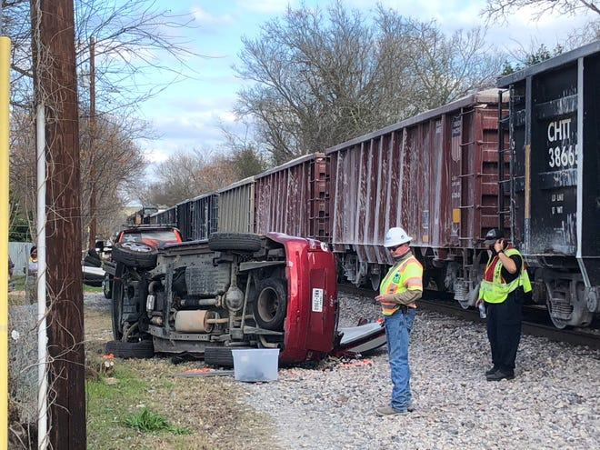 A red Jeep vehicle is located several yards from the railroad crossing near the intersection of Wilson Street and Hawthorn Street in Bastrop. The Bastrop Police Department and Bastrop Fire Department are on the scene of an apparent collision Friday afternoon between a car and a train.