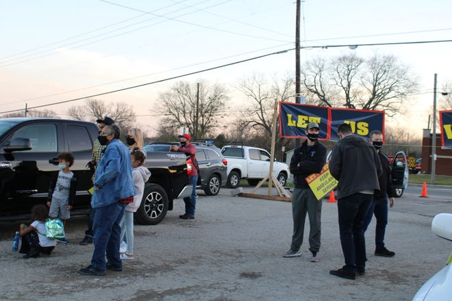 The Pflugerville Professional Firefighters Association and residents gathered on Tuesday night for a rally at El Rincon's parking lot, demanding that the council let them vote in May on a ESD overlay plan.