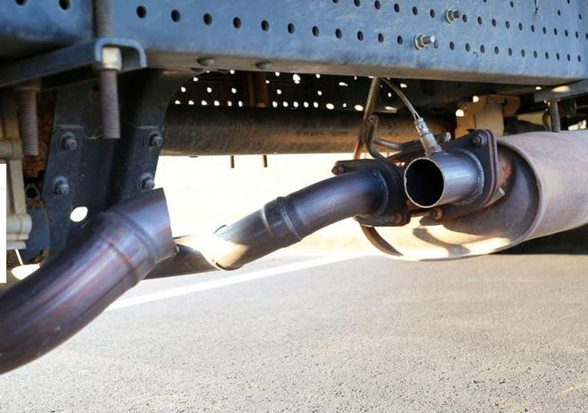 Thieves cut the pipes near the muffler to steal a catalytic converter off a vehicle.