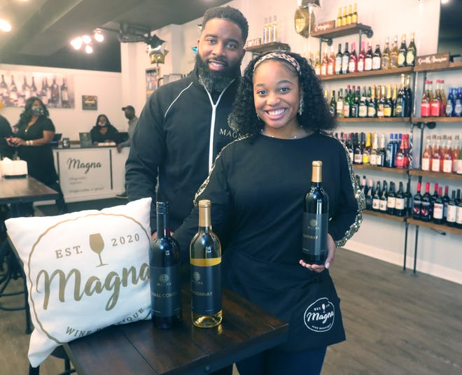 Magna Wine Boutique owners Dre and Brittany Wiley before a Jan. 29 ribbon-cutting ceremony for their new business in Cuyahoga Falls.