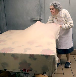 "Lucija ""Lou"" Strebick, 93, stretches the dough until it is paper thin to make her famous apple strudel at the New Era Cafe in Akron."