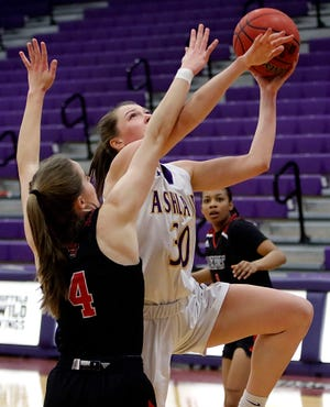 Ashland's Kayla Sanders (30) goes up for a shot against Davenport's Scout Nelson (4) during AU's 62-56 win Friday at Kates Gymnasium.