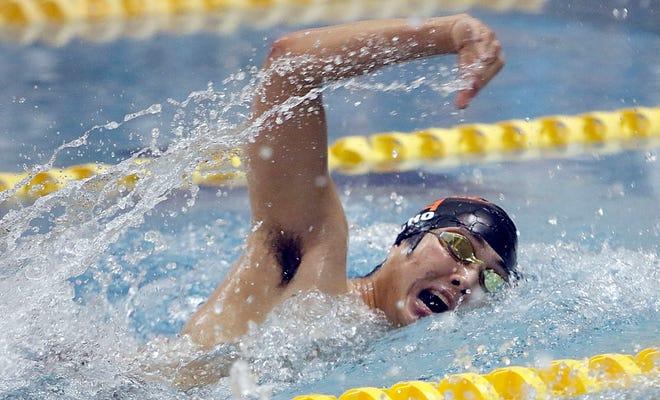 Ashland's Daniel Cho competes in the 200 freestyle during the meet against New Philadelphia Thursday at Ashland University's Messerly Natatorium.