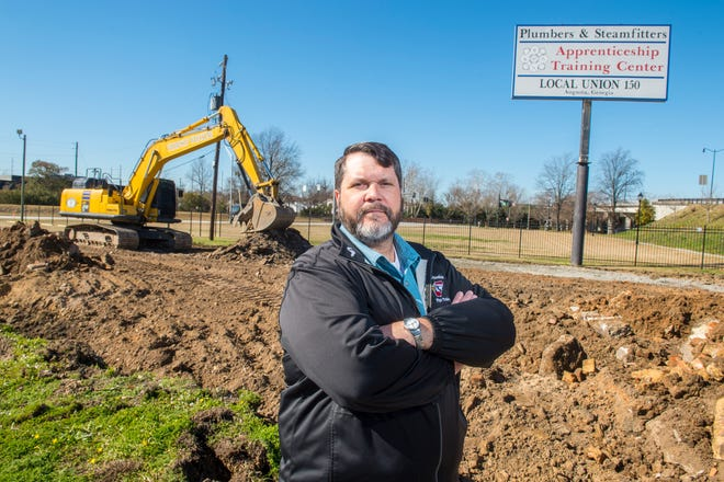 Bill Wright, the business manager for the Plumbers and Steamfitters Union Local 150, stands at the future site of an apprentice training center in downtown Augusta.