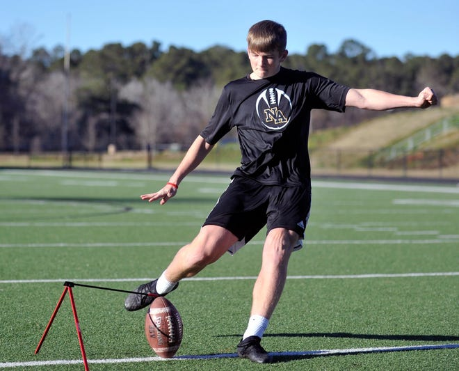 Drew Stevens attempts a kick while practicing on Thursday, Jan. 28, 2021 at North Augusta High School. [WYNSTON WILCOX/THE AUGUSTA CHRONICLE]