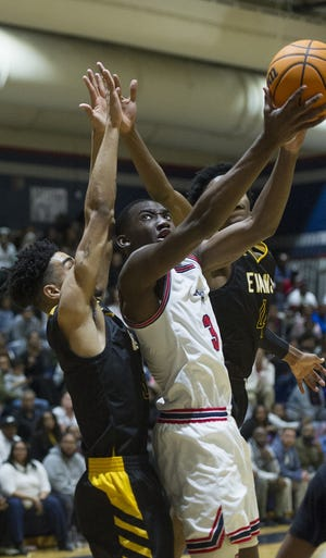 Jadis Gant of Grovetown, right, attempts a shot as Daniel Simpson of Evans defends at the high school basketball game between Evans and Grovetown in Grovetown, GA. on Tuesday, January 21, 2020. [MIKE ADAMS/FOR THE AUGUSTA CHRONICLE]