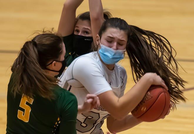 Beaver High School[s Payton List (32) tries to pass around Blackhawk's Quinn Borroni (5)  during their game Thursday at Beaver Area High School.