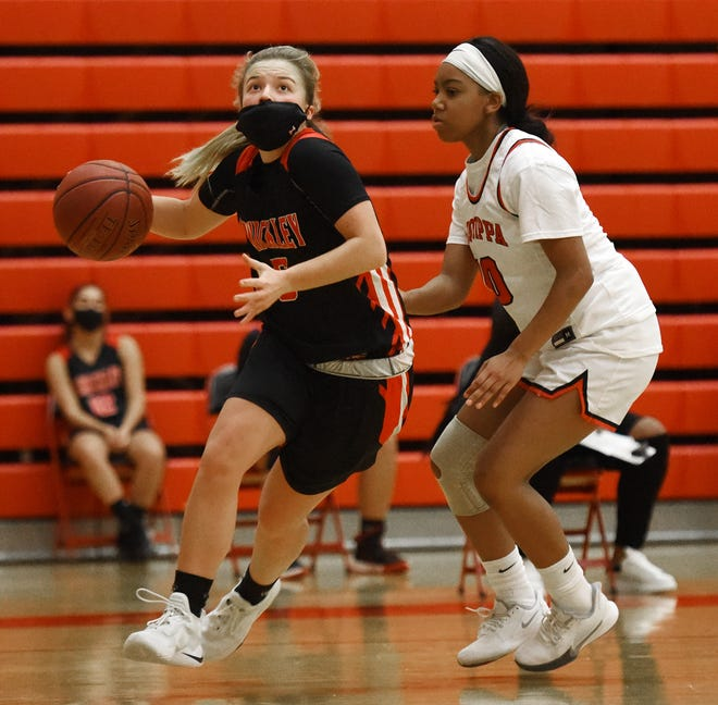 Sewickley's Hailey Drutarosky drives to the hoop with pressure from Aliquippa's Anieja Thomas during Thursday night's game at Aliquippa.