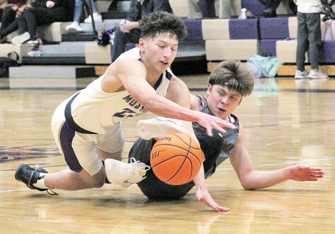 Wesleyan Christian School's Kade Kelley, left, and a Barnsdall High player scramble for a loose ball during varsity boys basketball play Thursday at WCS.
