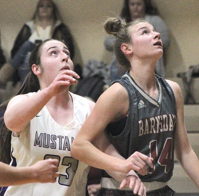 Wesleyan Christian's Janelle Arnold, left, and Barnsdall High's Ashley Johnson battle for rebounding position during Thursday's girls varsity basketball battle at WCS.