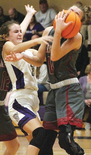 Wesleyan Christian School guard Kenzie Hendrix, left, scraps with a Barnsdall High player for a rebound during varsity girls basketball play Thursday at WCS.