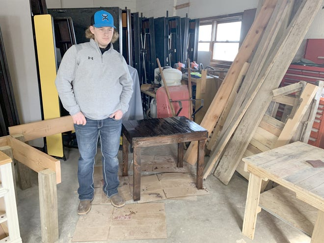 Ag instructor Chris Herriman took this picture of Caden Pearcy standing by the table he made with pallet wood in his Entrepreneurship class at Bunceton High School.