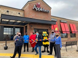 Following a four year absence, the Applebee's location in Andover reopened following a ribbon cutting ceremony this week. The ribbon was cut by Thrive president Jon Rolph.