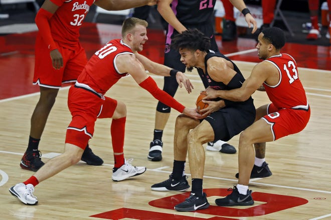 Ohio State Buckeyes guard CJ Walker (13) fouls Penn State Nittany Lions forward Seth Lundy (1) during the first half of their game at Value City Arena in Columbus, Ohio on January 27, 2020.