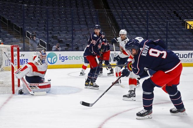 Mikko Koivu (9) rips a shot past Panthers goaltender Chris Driedger during the first period of the Blue Jackets' 3-2 shootout victory Thursday. The center played his first games for Columbus this week after sitting out because of COVID-19 protocols.