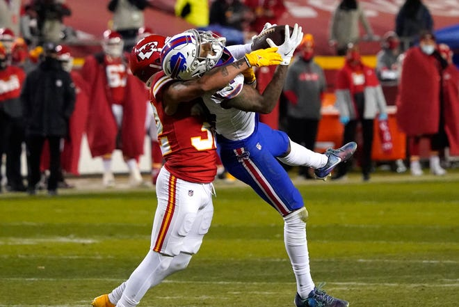 Buffalo Bills wide receiver Stefon Diggs is tackled by Kansas City Chiefs safety Tyrann Mathieu after catching a pass during the AFC championship game last Sunday.