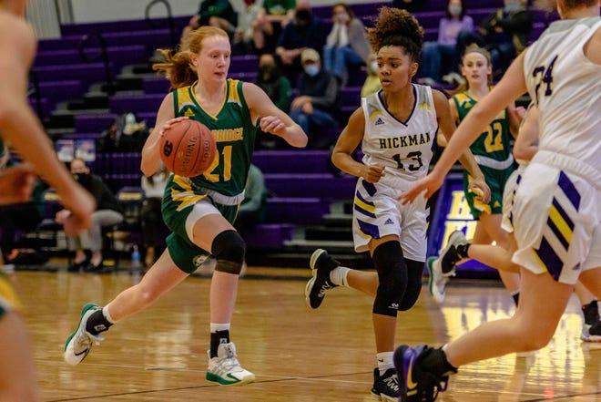 Rock Bridge's Averi Kroenke (21) rushes past Hickman's Kalia Naylor (13) during a game Thursday night at Hickman High School.