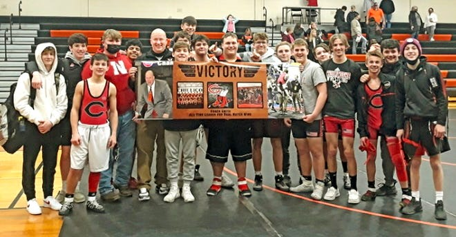 Members of the 2021-21 Chillicothe High School wrestling Hornets pose with seventh-year head coach Chad Smith (shaven head, left center) Thursday night at Macon after CHS' sweep of dual matches against the hosts and North Callaway raised Smith's dual-matches wins total as CHS coach to 138. That moved the coach into the top spot in all-time dual coaching wins for the Chillicothe program, breaking the tie with long-time coach Doug Long, who amassed 136 over 20 seasons.