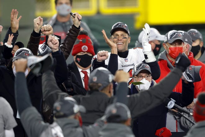Tampa Bay Buccaneers quarterback Tom Brady celebrates with his teammates after winning the NFC championship NFL football game against the Green Bay Packers in Green Bay, Wis., Sunday, Jan. 24, 2021. The Buccaneers defeated the Packers 31-26 to advance to the Super Bowl. (AP Photo/Jeffrey Phelps)