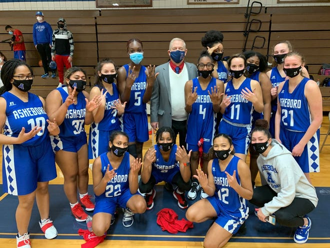 Asheboro girls basketball coach Don Corry celebrates his 700th career win after the Blue Comets beat Southwestern Randolph on Jan. 22. [Contributed photo]
