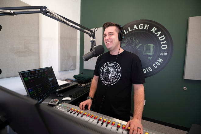 Chris English records a message for his radio station, My Village Radio in Leesburg. [Cindy Peterson/Correspondent]