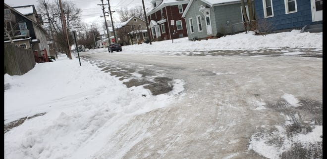 Thick ice covers much of the intersection of Short and Myrtle streets on Erie's west bayfront.  City streets crews, responding to citizen complaints, are working to clear ice from many of the city's side streets.