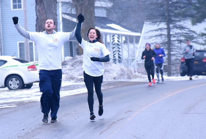An enthusiastic couple nears the completion of the 2020 Beer and Chili Run in Newport.