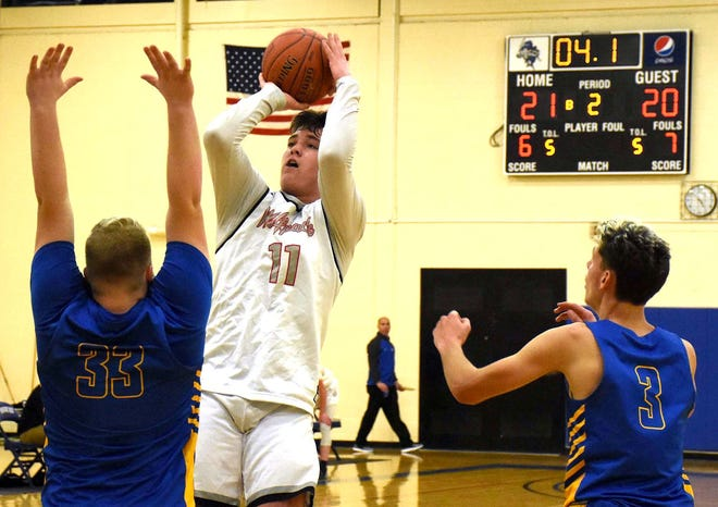 Returning Oppenheim-Ephratah-St. Johnsville senior Travis LaFountain (11) attempts a shot against Mayfield during a Dec. 8, 2019, game at Fulton-Montgomery Community College.