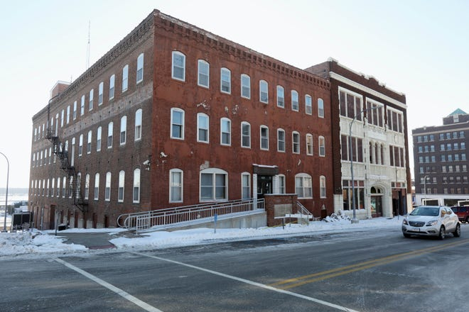The former Burlington Police Department building is shown Thursday in downtown Burlington. Demolition on the building along with the adjacent property is set to begin within the next two months to make way for a new, more than 40,000-square-foot apartment and commercial building. Merge LLC is utilizing opportunity zones to aid in the development.