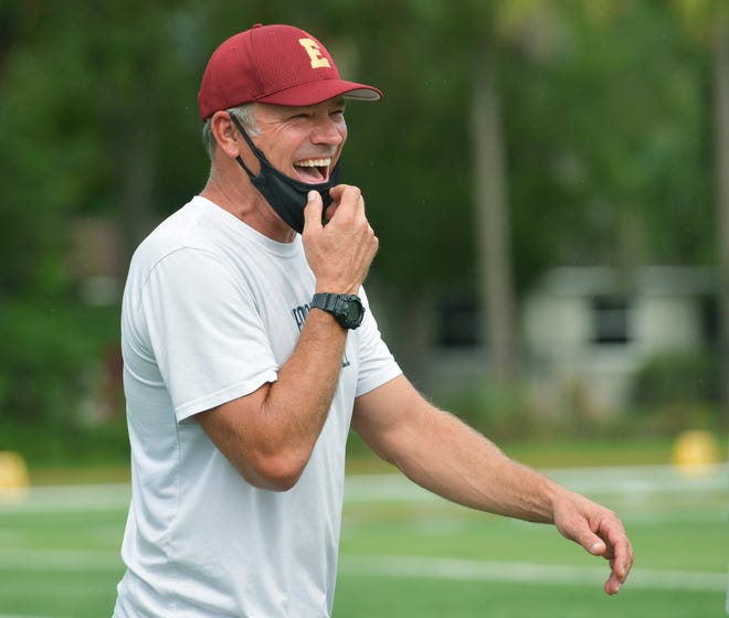 Head football coach Mark Brunell talks with players during a September practice at Episcopal School of Jacksonville.