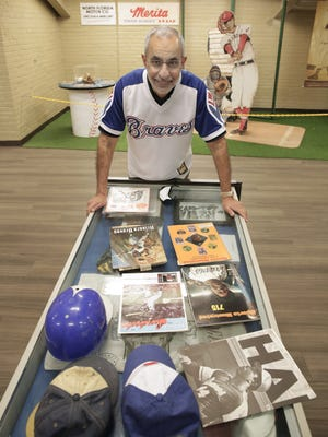 Ron Salem, a member of the Jacksonville City Council and a fan of Hank Aaron since he was a child, with some of his Hank Aaron collection that he started as a kid.
