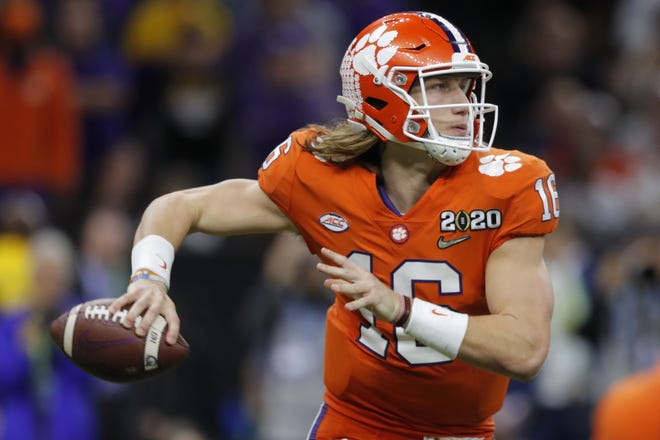 FILE - Clemson quarterback Trevor Lawrence passes against LSU during the second half of a NCAA College Football Playoff national championship game in New Orleans, in this Monday, Jan. 13, 2020. AP Photo/Gerald Herbert, File)