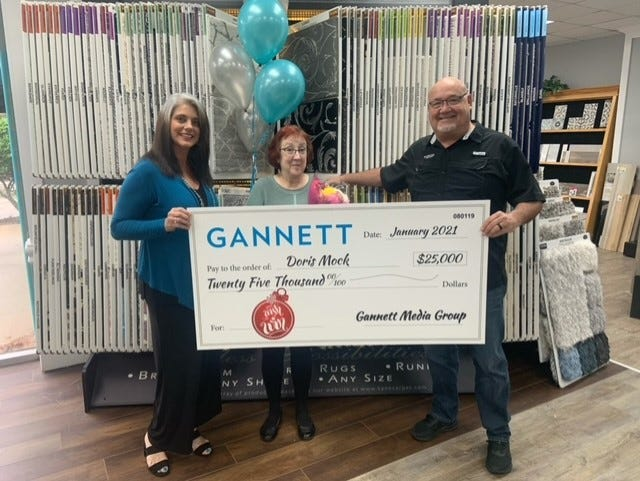 Bonnie Fenwick (left), owner of Carpet One Floor & Home, Doris Mock, grand prize winner in Gannett's Wish and Win contest, and Mike Nichols, general sales manager at Carpet One, celebrate Mock's win in a Jan. 22 ceremony at the store, local sponsor of the national contest.