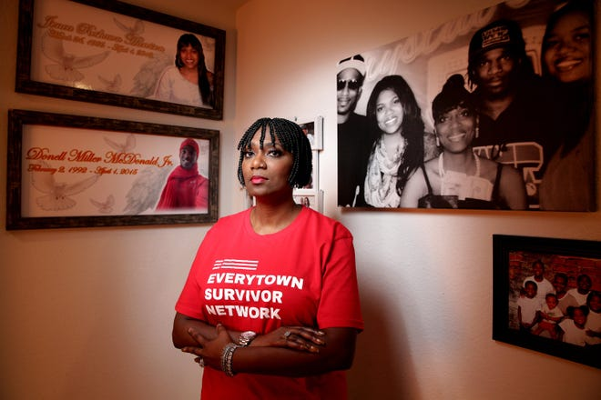 Family photos cover the walls of Crystal Turner's Jacksonville home, including of her slain son Donell McDonald and slain daughter Jenea Harvison, who were shot and killed in Columbus, Ohio, by Harvison's estranged husband in 2015.