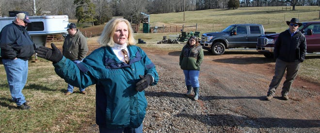 Beverly Phillips, with Phillips Farm, talks with officials about how nearby highway construction is damaging her property during a meeting Friday morning at her farm on Little Pond Drive.