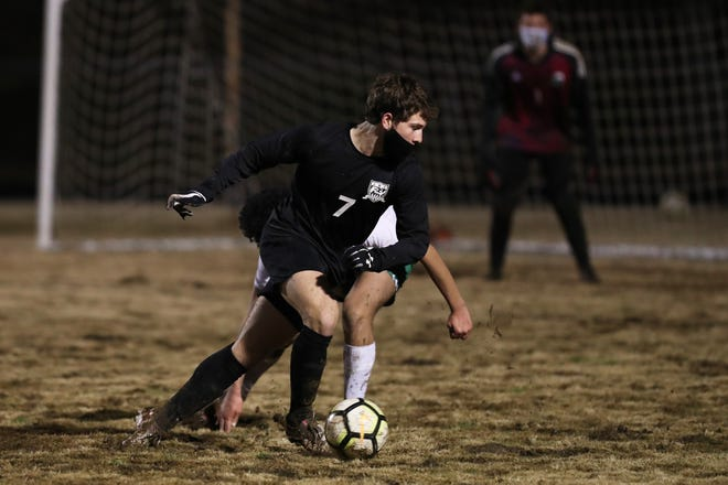 Forestview's Tyler McMurray tries to elude an Ashbrook defender during a recent game. [Brian Mayhew/Special to the Gazette]
