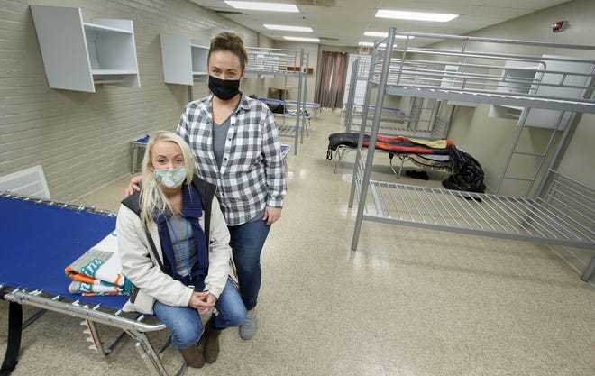 Community Outreach Coordinator Alicia Bridges and Marketing Director Tara Barker pose in the sleeping quarters at the new Men's Temporary Emergency Shelter in Shelby Friday afternoon, Jan. 29, 2021.