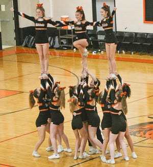 The Gardner High cheerleading team performs for the crowd during an Oakmont at Gardner boys' basketball game in 2019.