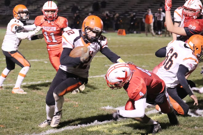 Gardner running back Zach Lemoine throws a stiff arm while trying to elude the tackle of Hudson's Josh Duarte during a 2019 game at the Morgan Bowl in Hudson.