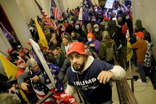 A pro-Trump mob enters the U.S. Capitol Building on Wednesday, Jan. 6, 2021, in Washington, D.C.
