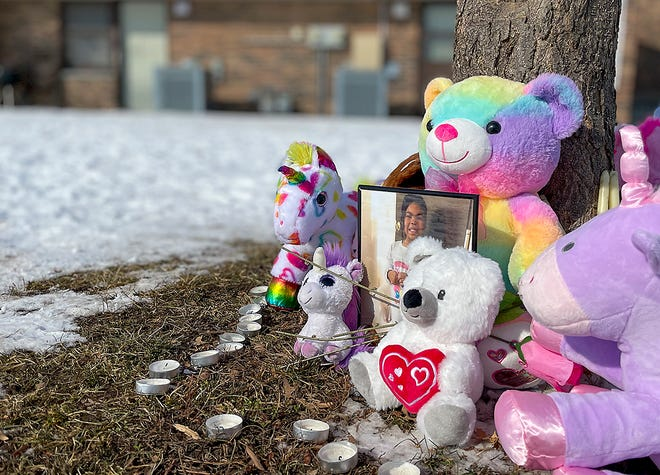 Brightly colored stuffed animals and candles surround a portrait of Willow Banks, 7, the day after a ballon launch in remembrance for the little girl who police say was stabbed by her mother in the 1500 block of McKnight Street on Jan. 24, 2021.