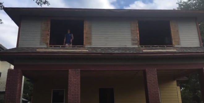 Builders work to renovate a home in a screenshot of a Denison promotional video. Since it's launch three years ago, Denison's residential renovation program has seen 125 properties take advantage of incentives.