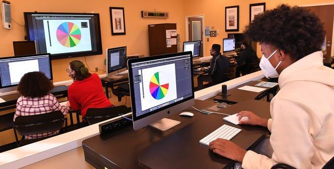 Students in Iosep MacDougall's Digital Arts class, including Triallen Washington, right, work on a project at the South Carolina School for the Deaf and the Blind, in Spartanburg, Thursday, January 28, 2021.