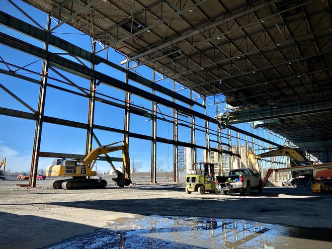 """In this file photo, what once was a main generator building at the former Brayton Point Power Station in Somerset is being prepped as an area to store offshore wind components. """"Building the amount of offshore wind we will need to meet our climate goals will require thousands of workers in an industry that does not yet exist in the United States,"""" writes the author."""