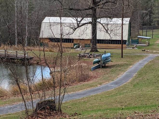 A barn and pond on the grounds of Talisman Camps in Zirconia.