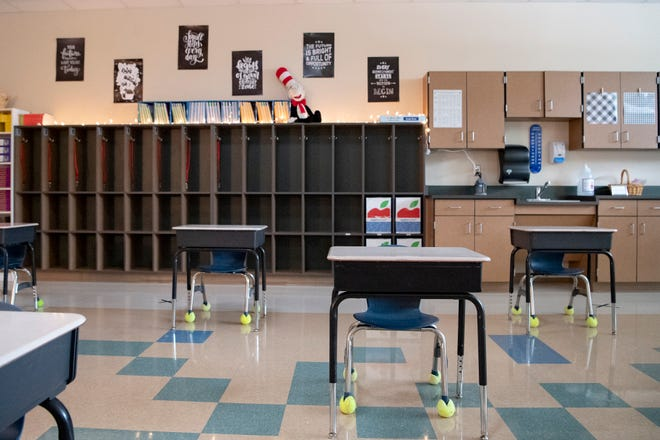 In this Sept.  21, 2020 photo, desks at Hillandale Elementary in East Flat Rock are arranged to give each student more space before they returned to in-person learning.