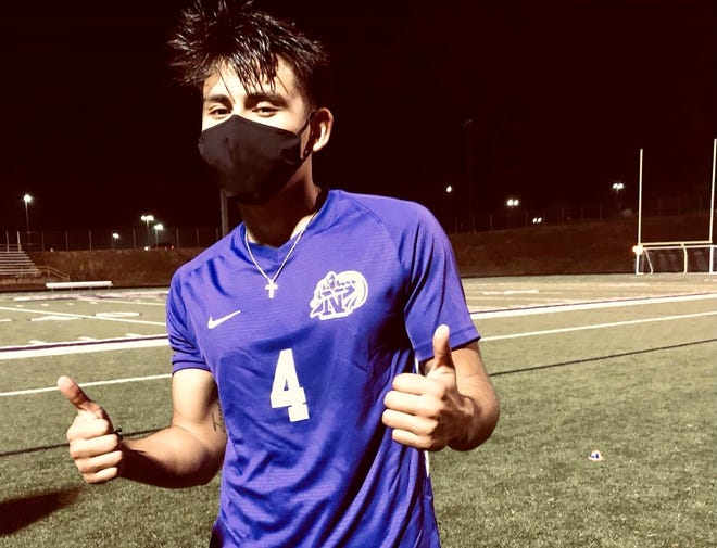 North Henderson boys soccer player Giancarlo Juarez gives the thumbs up signal during a match earlier this season. The North boys defeated Asheville on Thursday night at Asheville.