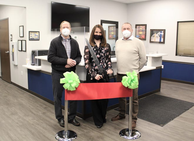 Officials with Xpress Wellness, from left, CEO Grant Asay, area manager Jharon Ellis and Chief Medical Officer Scott Williams conducted a ribbon-cutting at their new Hutchinson location on Wednesday.